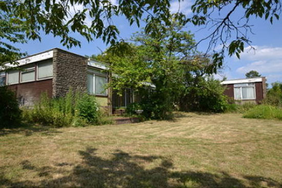 In need of renovation: 1960s Cox Architects-designed single-storey modernist property in Aylesbury, Buckinghamshire