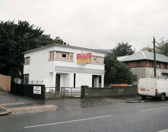 In need of renovation: Two-storey art deco office building/house in Belfast, Northern Ireland