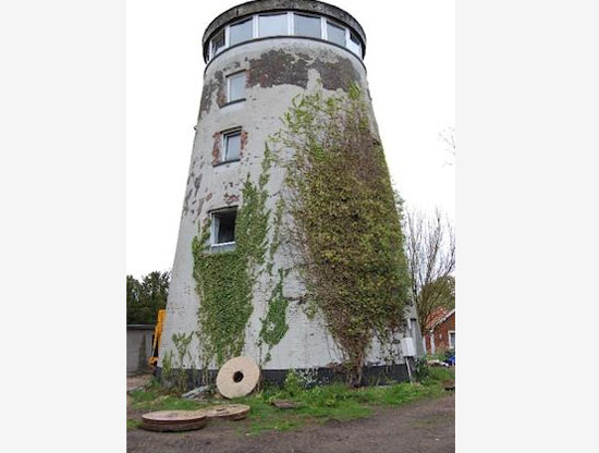 Once-restored five-storey mill and cottage in Diss, Norfolk