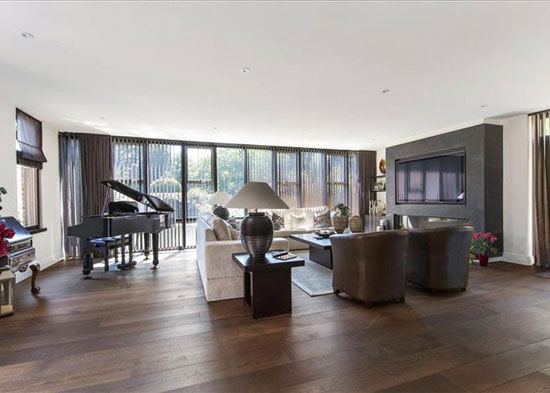 1970s Royston Summers-designed modernist lakeside property in Esher, Surrey