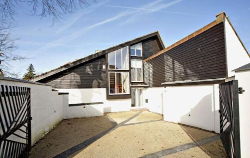 On the market: 1980s-designed five-bedroomed house in Frith Hill, Godalming, Surrey