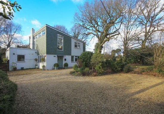 On the market: 1960s Malcolm MacDonald-designed four-bedroom property in Lymington, Hampshire