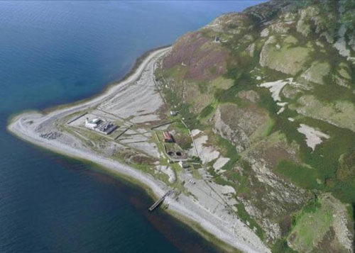 Ailsa Craig island and cottages on the outer Firth of Craig, Scotland