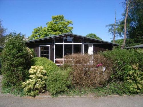 Live in the woods: Three-bedroomed wooden chalet in Llanbedrog, Gwynedd, North Wales