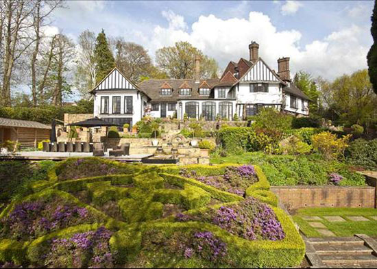 On the market: Kenwood Mansion on the St George's Hill Estate, Weybridge, Surrey – the former home of John Lennon