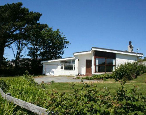 In need of renovation: Midcentury-style four-bedroom bungalow in Rhoscolyn, Anglesey, North Wales