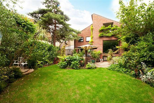 On the market: 1970s architect-designed High Timbers six-bedroomed house in Shepperton, Surrey