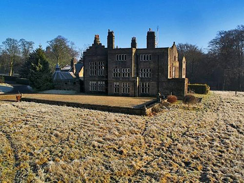 On the market: Gothic grade II-listed Huntroyde Hall in Simonstone, near Burnley, Lancashire