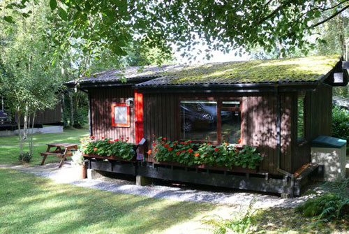 1970s Swiss-style wooden holiday lodge in Cenarth, Carmarthenshire, West Wales